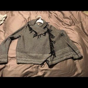 Stylish black and white jacket with fringe